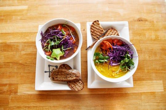 A vegetable soup, left, and lentil dahl at Elements Real Food in Asheville Nov. 14, 2018.