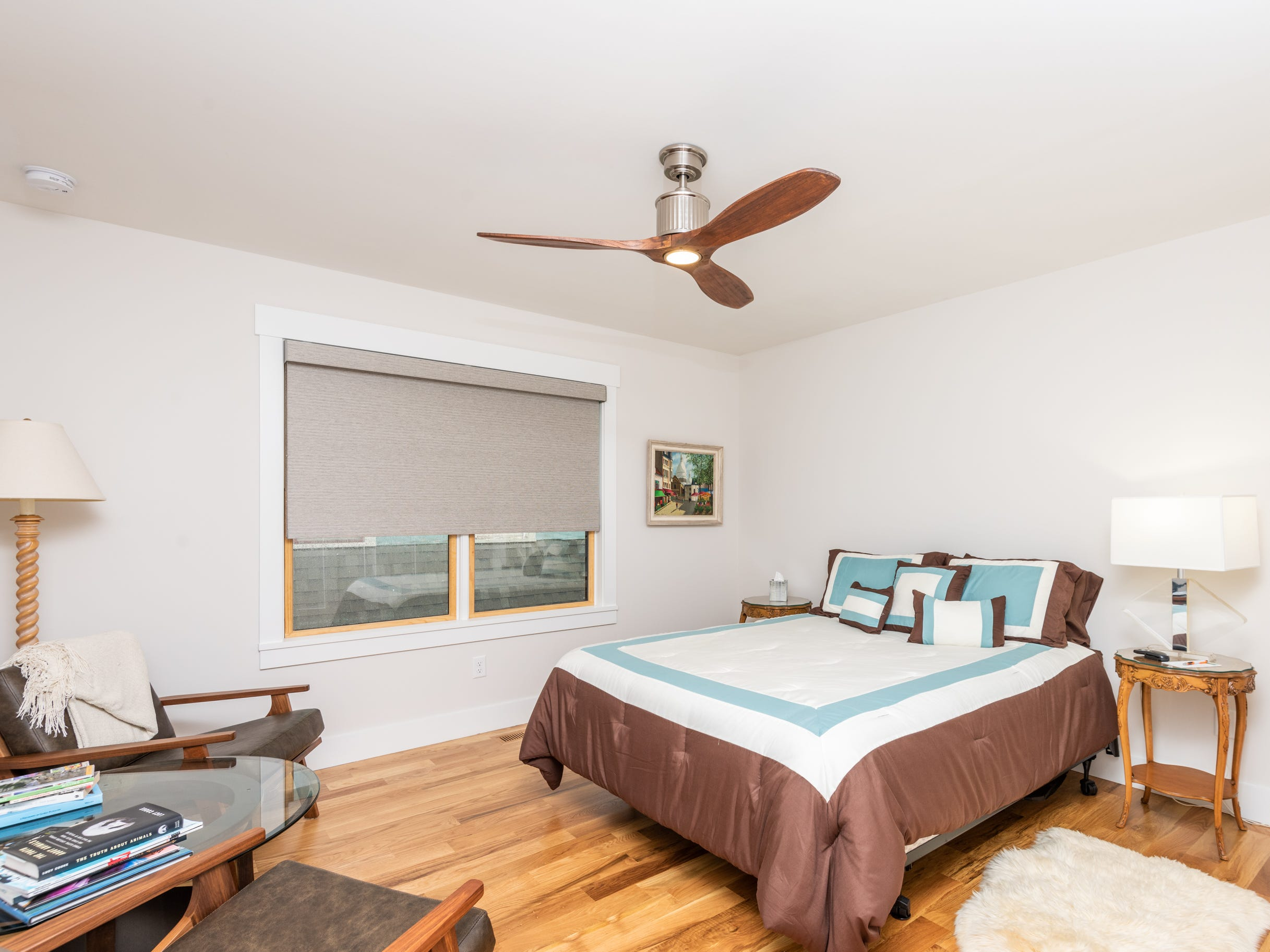 An upstairs bedroom keeps the design simple and uncluttered.