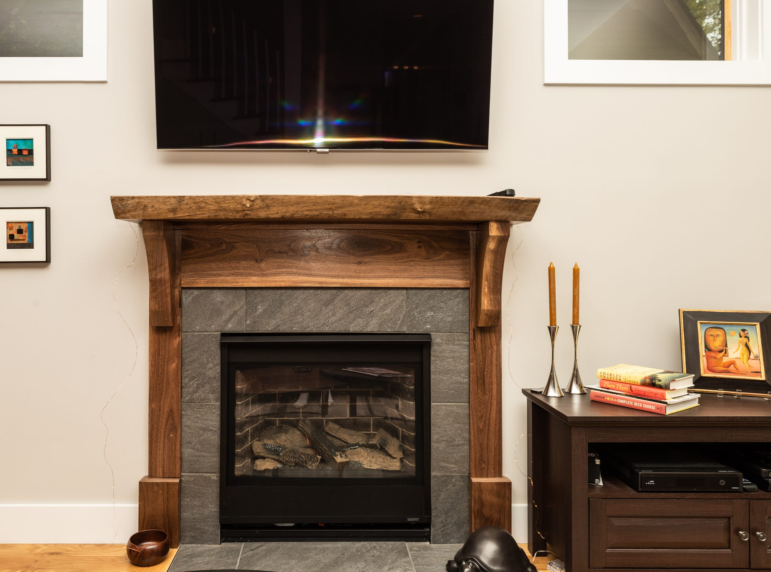 This wooden mantle i the livnig room was made locally.