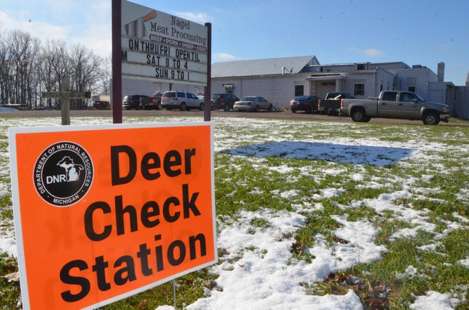 A sign for a DNR deer check station in front of Nagel Meat Processing in Homer.