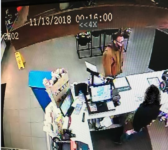 Battle Creek police are seeking to interview the man shown in a security photo from the Shell Station at Columbia and Capital avenues taken before a gift store burglary.