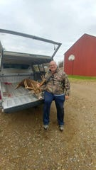Mark Smith of Homer displays the eight-point Buck he killed during Michigan bow season. He is having the buck mounted and its meat processed by Nagel's Meat Processing in Homer.