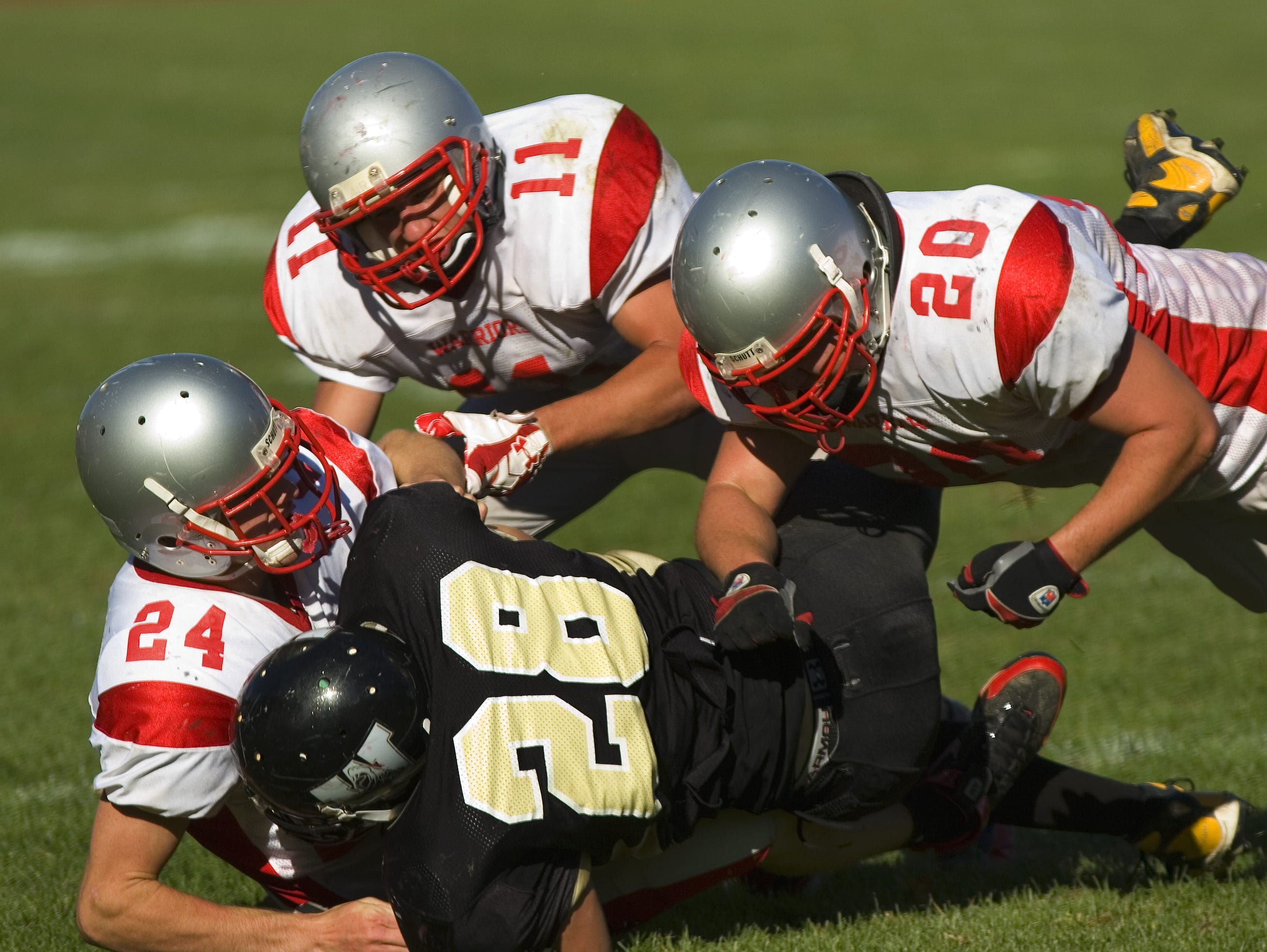 From 2008: Chenango Valley's defense of Thomas Courtney, left, Frankie Criscitello, center, and Matt Meddleton bring down Windsor running back Dylan Kay on Saturday afternoon in Windsor.