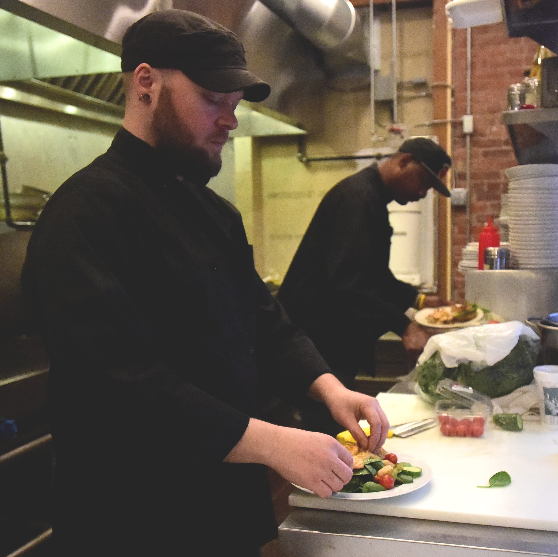 Jody Wilbur of Binghamton prepares a shrimp salad at Chatterbox Cafe, Tapas, and Oyster Bar on Main Street.