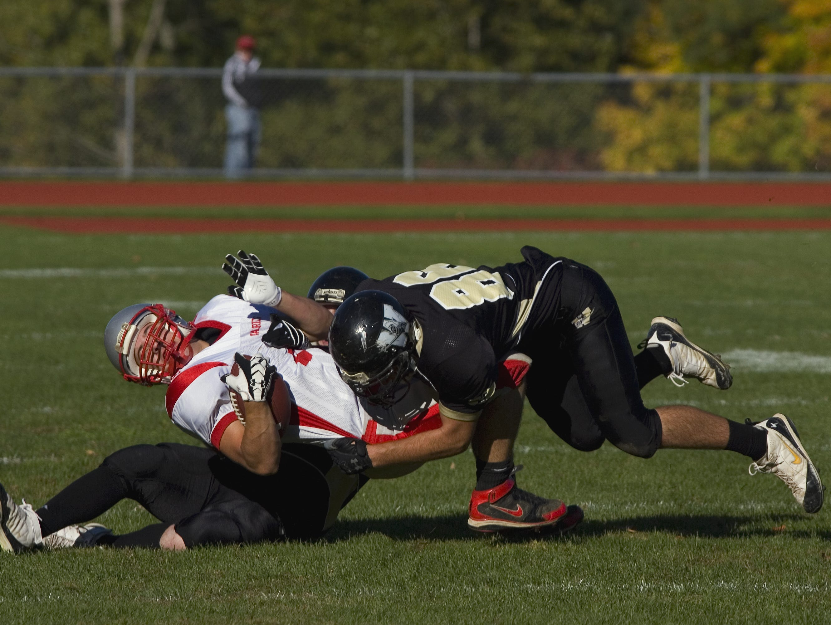 From 2008: Windsor's Richie DiVirgilio, right, and Timmy Costello, bottom, take down Chenango Valley's Ricky Ruffo in the fourth quarter Saturday afternoon in Windsor.