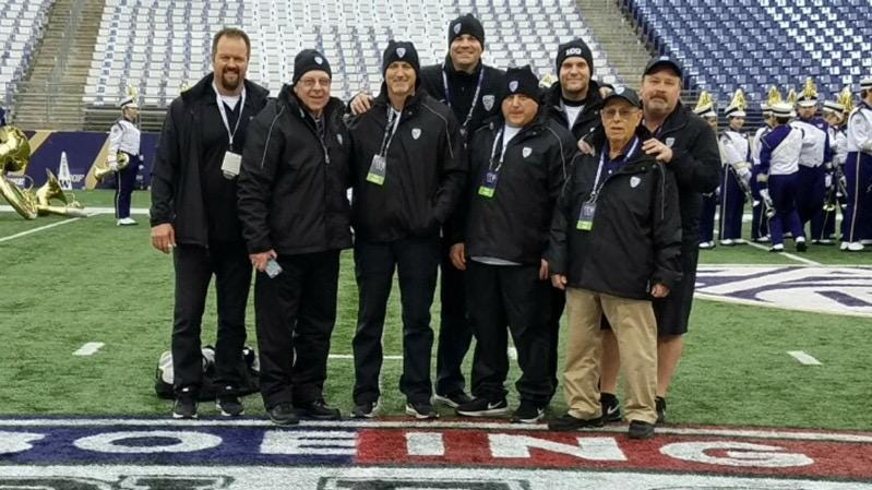 The group of Kitsap friends who work operations for Husky football games. From left, DJ Sigurdson, Bob McDonald, Mark Knowles, Billy Landram, Mike Ison, Bjorn Bjorke, Art Guidi, Gregg Guidi.