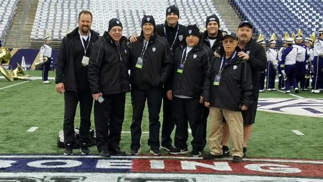 The group of Kitsap friends who work operations for Husky football games. From left, DJ Sigurdson, Bob McDonald, Mark Knowles, Billy Landram, Mike Ison, Bjorn Bjorke, Art Guidi, Gregg Guidi.