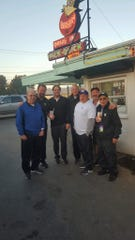 A group of friends from Kitsap is an integral part of Husky football home games. One tradition is to stop in Fife for pre-game milkshakes.