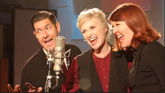 "Jane Lynch (middle) is joined by Tim Davis, Kate Flannery and the Tony Guerrero Quintet on the ""Swingin' Little Christmas"" tour."
