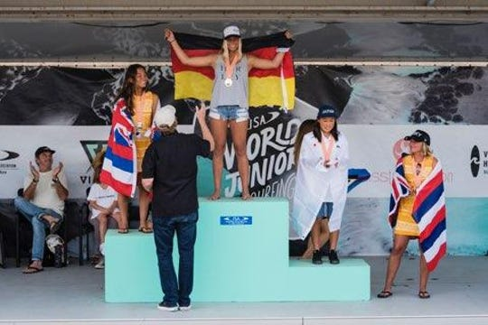 Rachel Presti stands atop the podium after winning the U-18 girls division at the International Surfing Association's World Junior Championships in Huntington Beach, California, on Nov. 4.