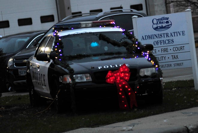 A cruiser is decorated in front of the Crestline Police station on Wednesday for the city's first responder toy drive, which is taking place from now until Dec. 15.