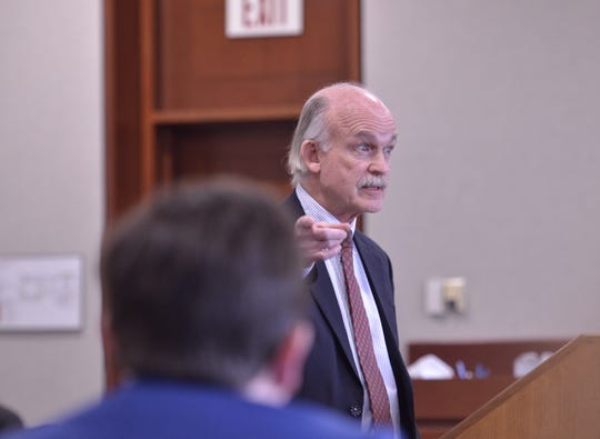 Ernest M. Allen, attorney to criminal justice teacher David Scibek, gave opening arguments to the jury on Nov. 14, 2018 at Vermont Superior Court. He gestures to the lawyers representing the state against his client.