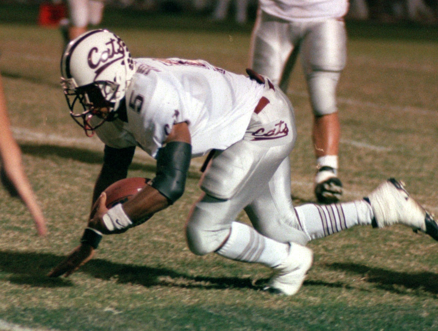 Calallen Cat's # 5 Victor Price is tripped up by G-P # 12 Mark Chester on a punt return in 2nd Q.