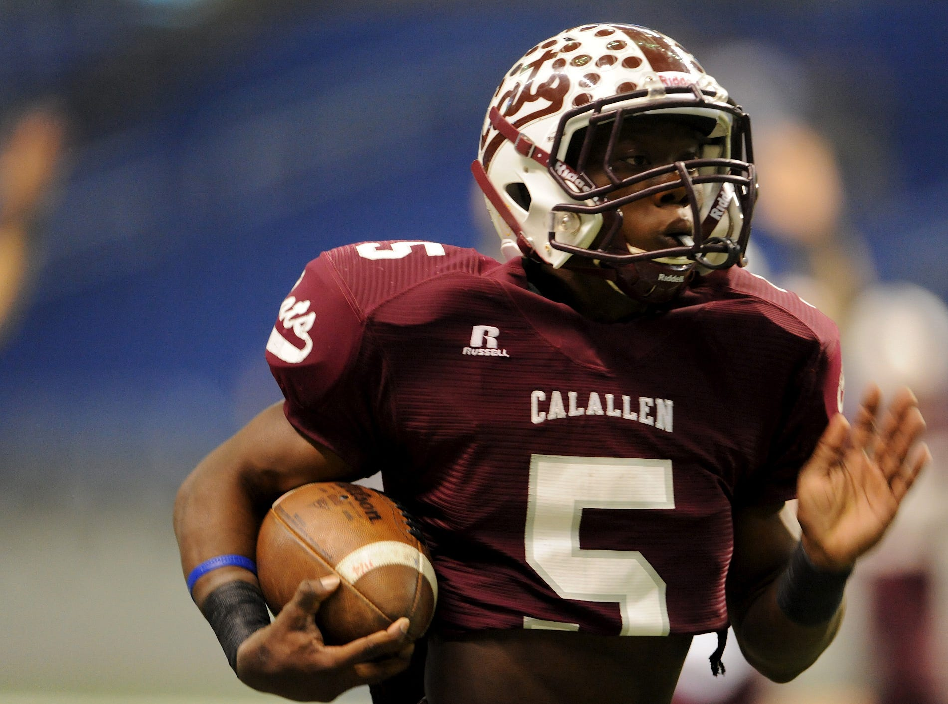 Calallen senior Marcus Price runs back his first of two kickoff returns for touchdowns during the Wildcats state semifinal football playoff game against Manvel.