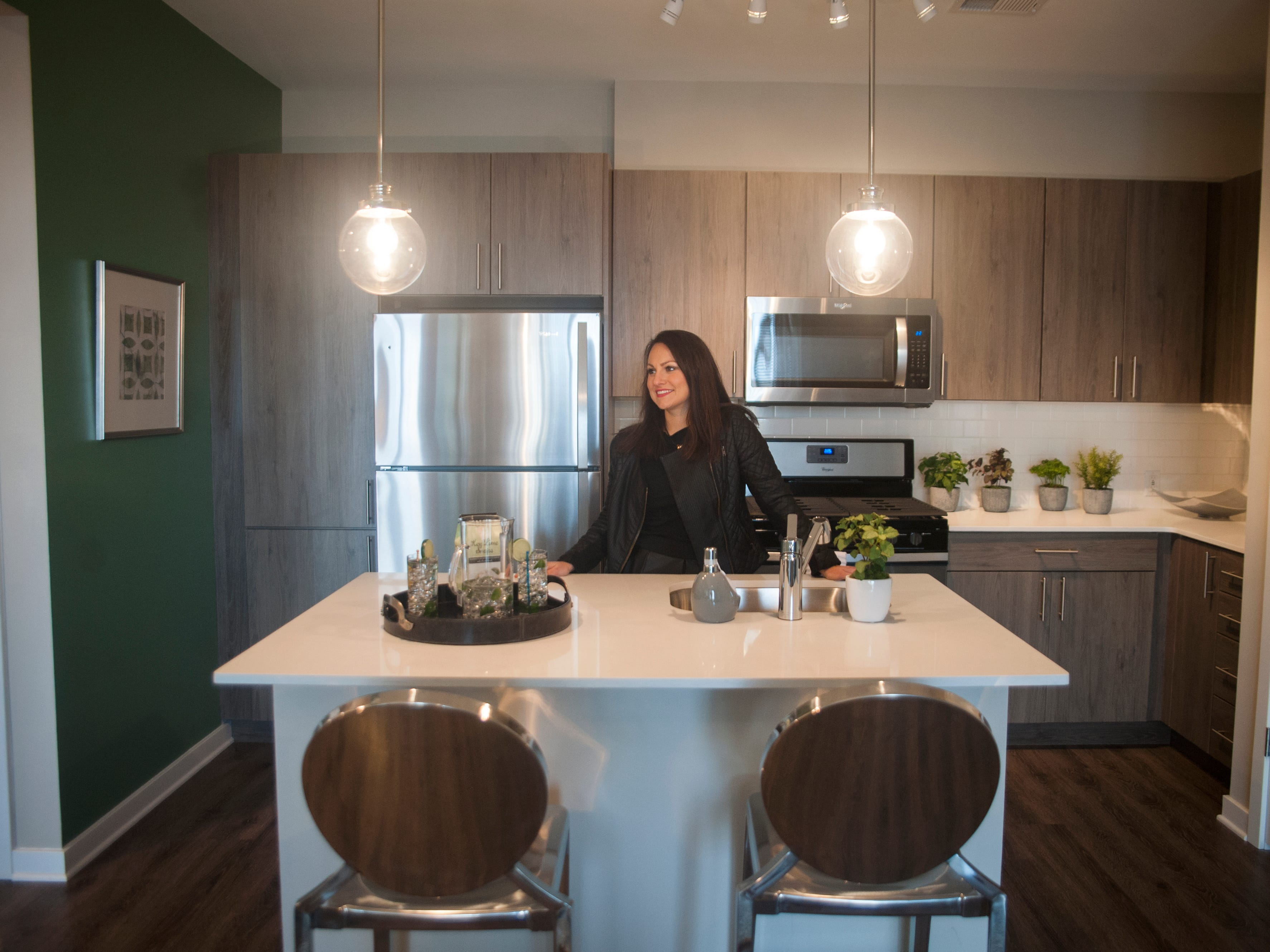 Teresa Sydorko, Director of Communications and Social Media for Delco Development, stands in the kitchen area of a model apartment of Haddon Point, a large-scale apartment complex located on the former Pennsauken Mart site, that opened Wednesday, November 14, 2018.