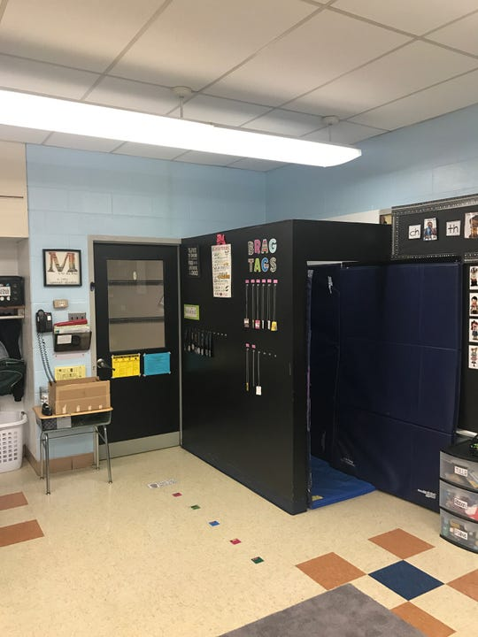 """Monroe Township Superintendent Richard Perry visited Whitehall Elementary School Wednesday to take a photo of the padded space inside a special education classroom. Perry said the space is called a """"calm down"""" room and is commonly used by school districts to help children with behavioral challenges."""