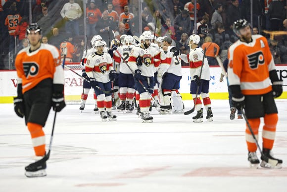 The Florida Panthers celebrate after defeating the Philadelphia Flyers at Wells Fargo Center.