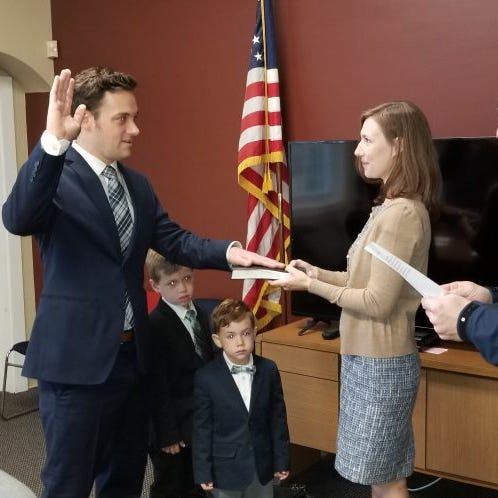 Ryan Linhart,with his wife Genevieve and their sons, takes the oath of office as a Haddon Township commissioner.