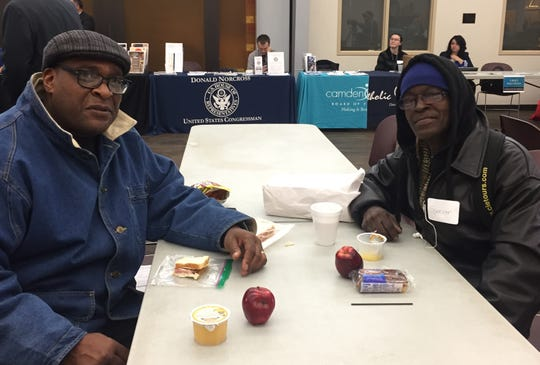 """Ernest """"Radio"""" Lindsay (left) shares sandwiches, snacks and conversation with Spencer Furman. Lindsay transitioned from homelessness to outreach at Joseph's House of Camden and was trying to persuade Furman to take advantage of assistance for homeless people."""