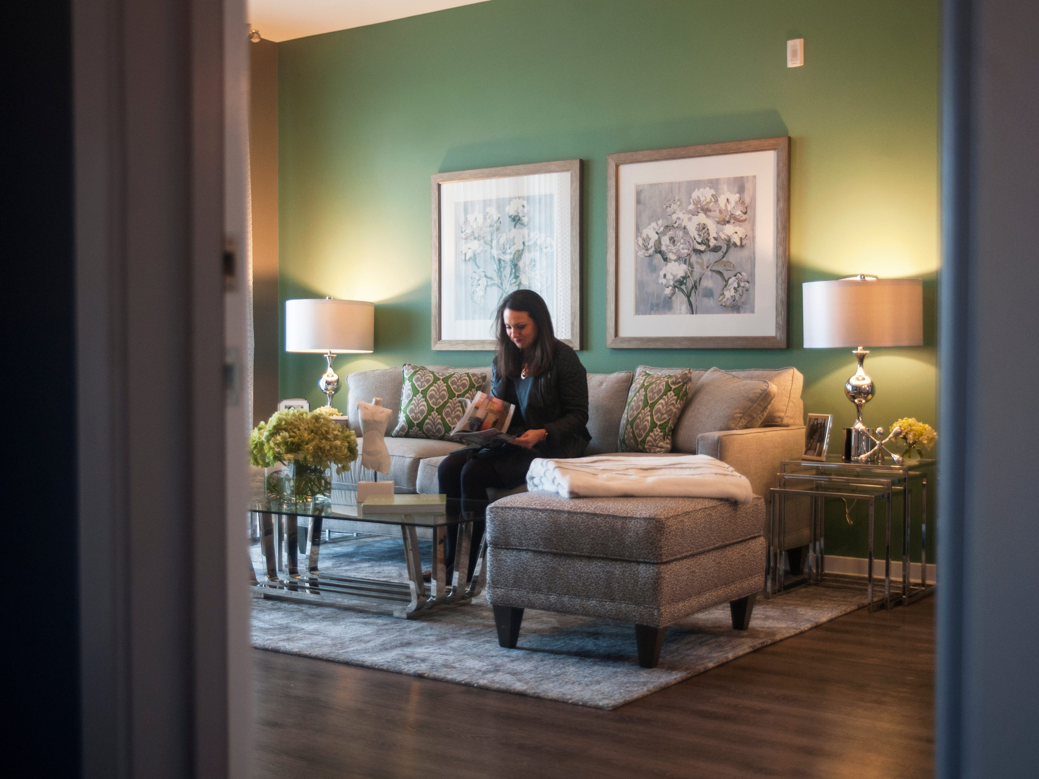 Teresa Sydorko, Director of Communications and Social Media for Delco Development, sits in the living room of a model apartment at Haddon Point, a large-scale apartment complex located on the former Pennsauken Mart site, that opened Wednesday, November 14, 2018.