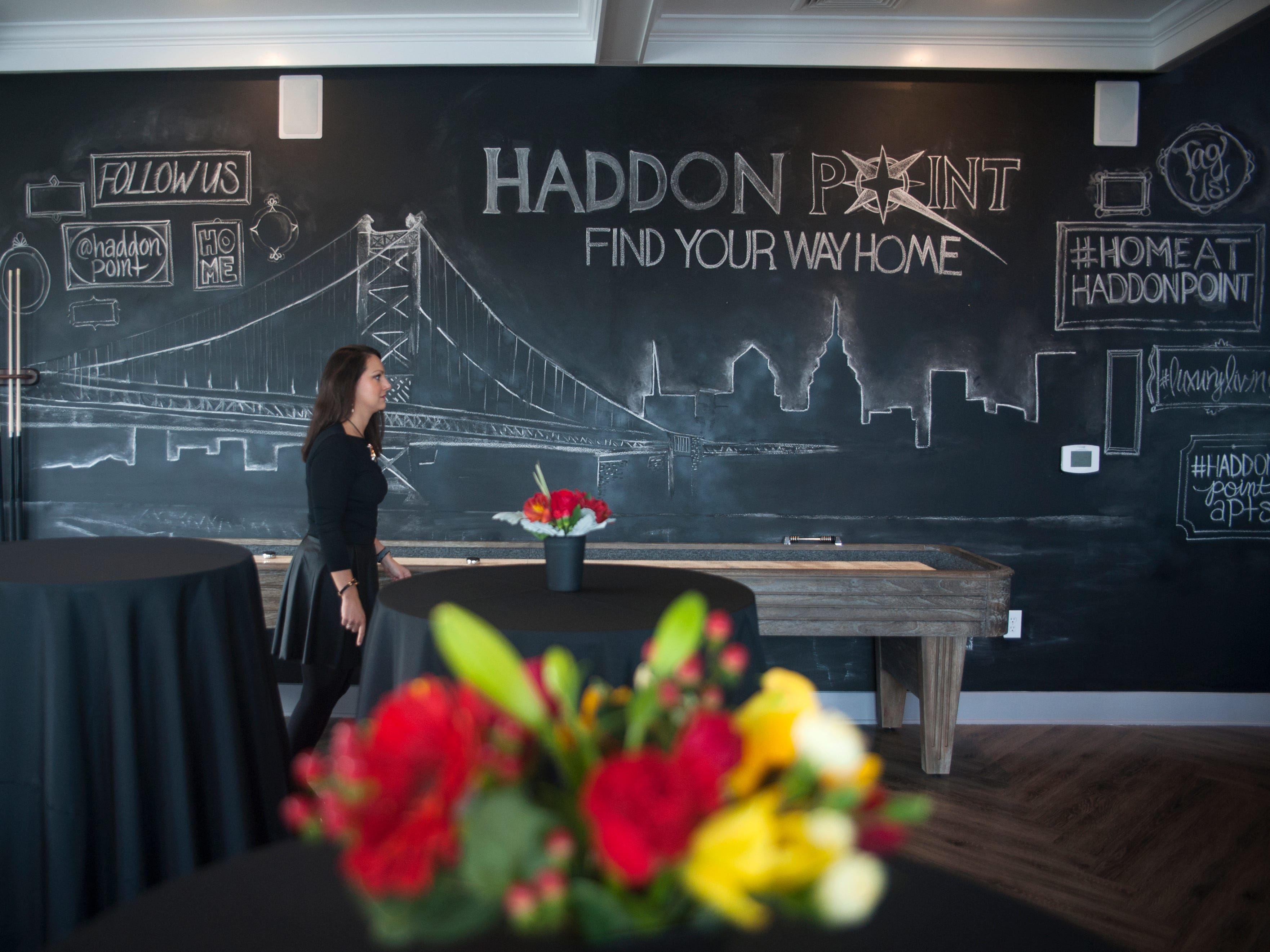 Teresa Sydorko, Director of Communications and Social Media for Delco Development, stands in the clubhouse game room of Haddon Point, a large-scale apartment complex located on the former Pennsauken Mart site, that opened Wednesday, November 14, 2018.