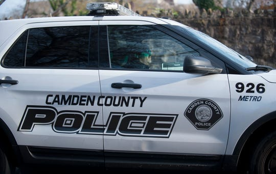 A Camden County Police official patrols Euclid Avenue in Camden on Wednesday, November  14, 2018, near the site where 15-year-old  Javonne Davis was fatally shot on Tuesday afternoon as he walked home from school.