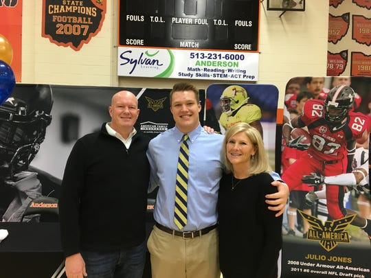 Zeke Correll of Anderson signed to play football with Notre Dame. He is with his parents, Steve and Lisa.