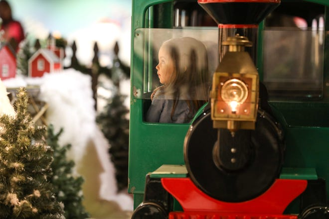 The Holiday Junction featuring the Duke Energy Holiday Trains at Union Terminal will be open to the public on Saturday Nov. 17. Holiday Junction is a multi-gallery holiday experience, that includes the historic Duke Energy Holiday Trains in a new space with a new perspective. Magnolia Bartoszek, 2, of Fort Thomas rides around in a train that circles one of the exhibits.