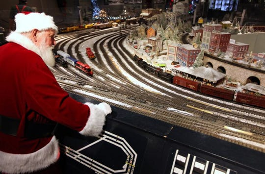 Santa Claus gets an early peek at the Duke Energy Holiday Trains at the Cincinnati Museum Center.