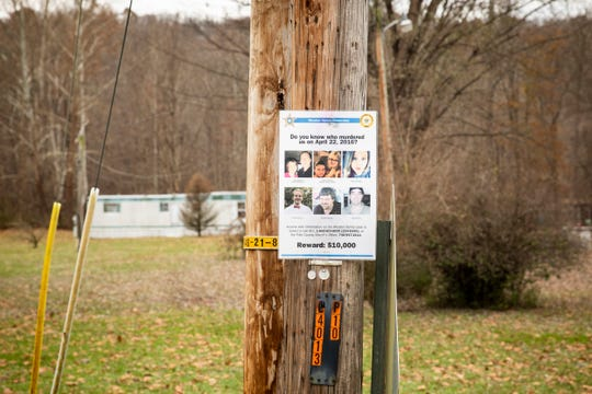 """A reward sign for the Rhoden family homicides is posted across the street from the Flying W Farms Wednesday, November 14, 2018. This farm belongs to the Wagner family. Angela Wagner, her husband George """"Billy"""" Wagner, and their two sons, George Wagner and Edward """"Jake"""" Wagner, have each been charged in the gruesome deaths of the Rhoden family and Hannah Gilley."""