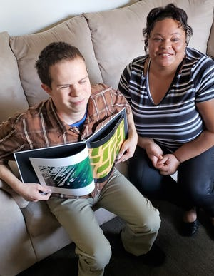 Linda Barnfield, one of Envision's most valued foster care providers and Michael, a 22-year old with high-functioning autism and other disabilities, including hearing loss and blindness.