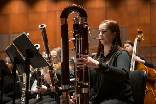 A contrabassoonist plays in a 2017 performance of the College-Conservatory of Music's Wind Symphony, one of the nearly 1,000 performances presented annually by CCM.