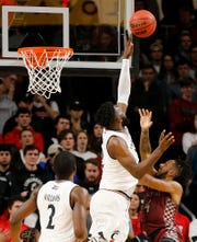 Cincinnati Bearcats forward Eliel Nsoseme (22) blocks a shot by North Carolina Central Eagles guard Jordan Perkins (4) in the first half of the NCAA basketball game between the Cincinnati Bearcats and the North Carolina Central Eagles at Fifth Third Arena in Cincinnati on Tuesday, Nov. 13, 2018. The Bearcats led 34-19 at halftime.