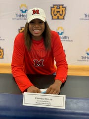 Kennedi Myles of Walnut Hills signed her letter of intent to play basketball for Miami University of Ohio Nov. 14.