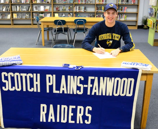 Scotch Plains-Fanwood's Josh Cohen signs his NLI to swim for Georgia Tech on Wednesday, Nov. 14, 2018.