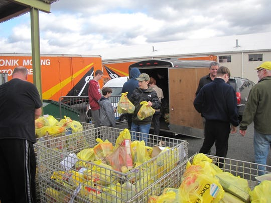 Scouts unload donated food at the Somerset County Food Bank.