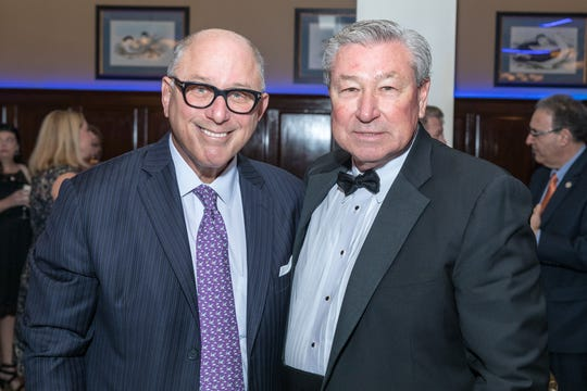Steve Kalafer, founding chairman, Flemington Car & Truck Country Family of Brands and Somerset Patriots, left, receives congratulations from Robert Wise, RVCC Board of Trustees chair, for being honored as a Civic Leader at RVCC's Golden Harvest Gala.
