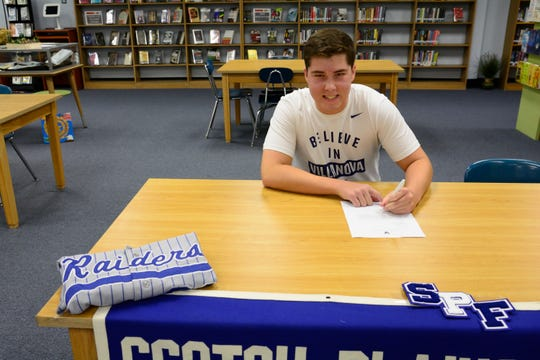 Scotch Plains-Fanwood's Dan Wilkinson signs his NLI to attend Villanova on Wednesday, Nov. 14, 2018.
