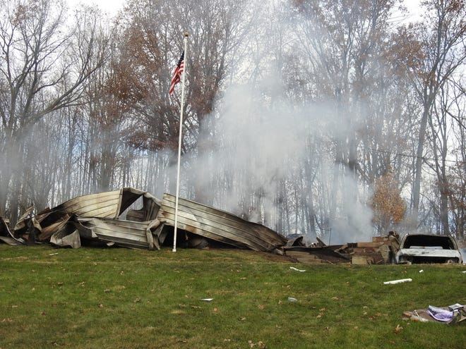 Authorities report an explosion and fire destroyed the Fosters' mobile home in the early morning hours of Wednesday in the 43000 block of County Road 58.