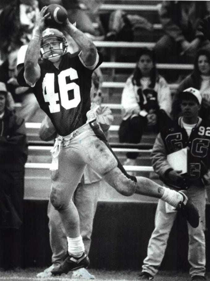From 1992: Iowa tight end Matt Whitaker catches a pass during Iowa's spring game in April 1992.
