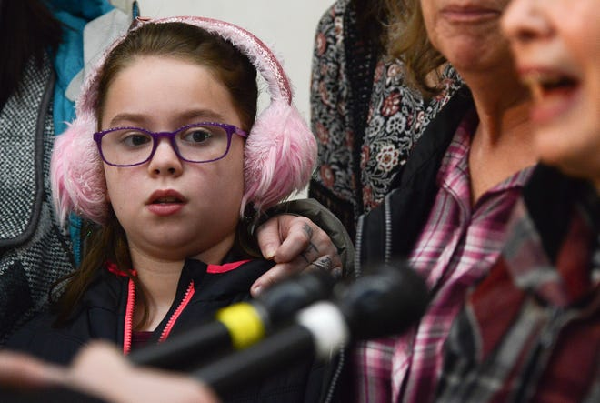 Robert Howe's great-granddaughter, Kadyn, listens as her great-grandmother, Marilyn, speaks with reporters after Howe's convicted killer was sentenced to life in prison Wednesday, Nov. 14, 2018, at the Polk County Courthouse in Des Moines.
