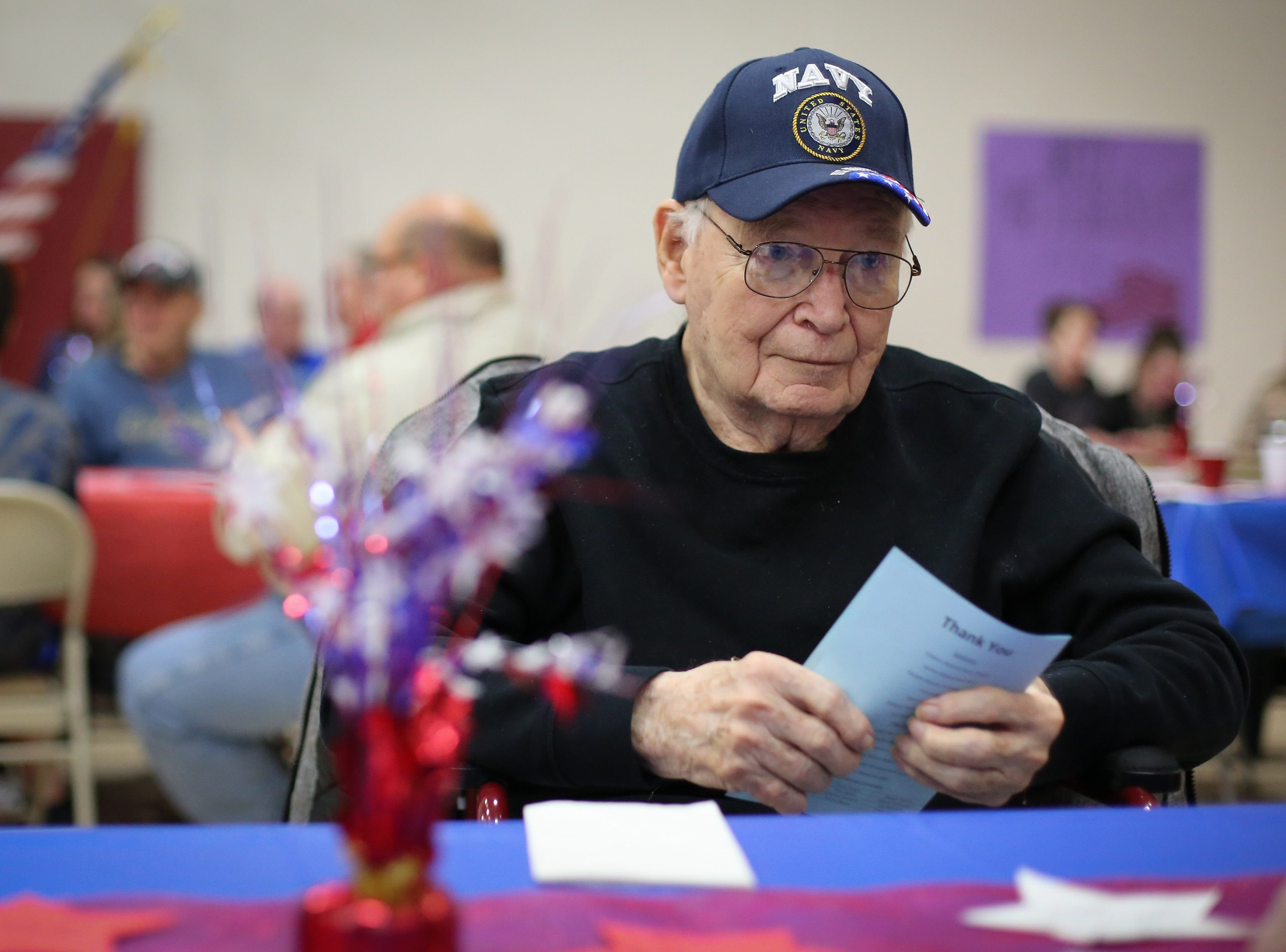 Jack Maul, a naval veteran, looks on during the Veterans Day Breakfast at Northview Middle School on Wednesday, Nov. 14, 2018 in Ankeny, Iowa. Middle school students hosted the veterans to share their gratitude before an assembly.