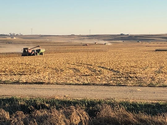 Volunteers help harvest corn on the Kellen family farm Tuesday in Le Mars. Three members of the Kellen family were killed Friday in a plane crash.
