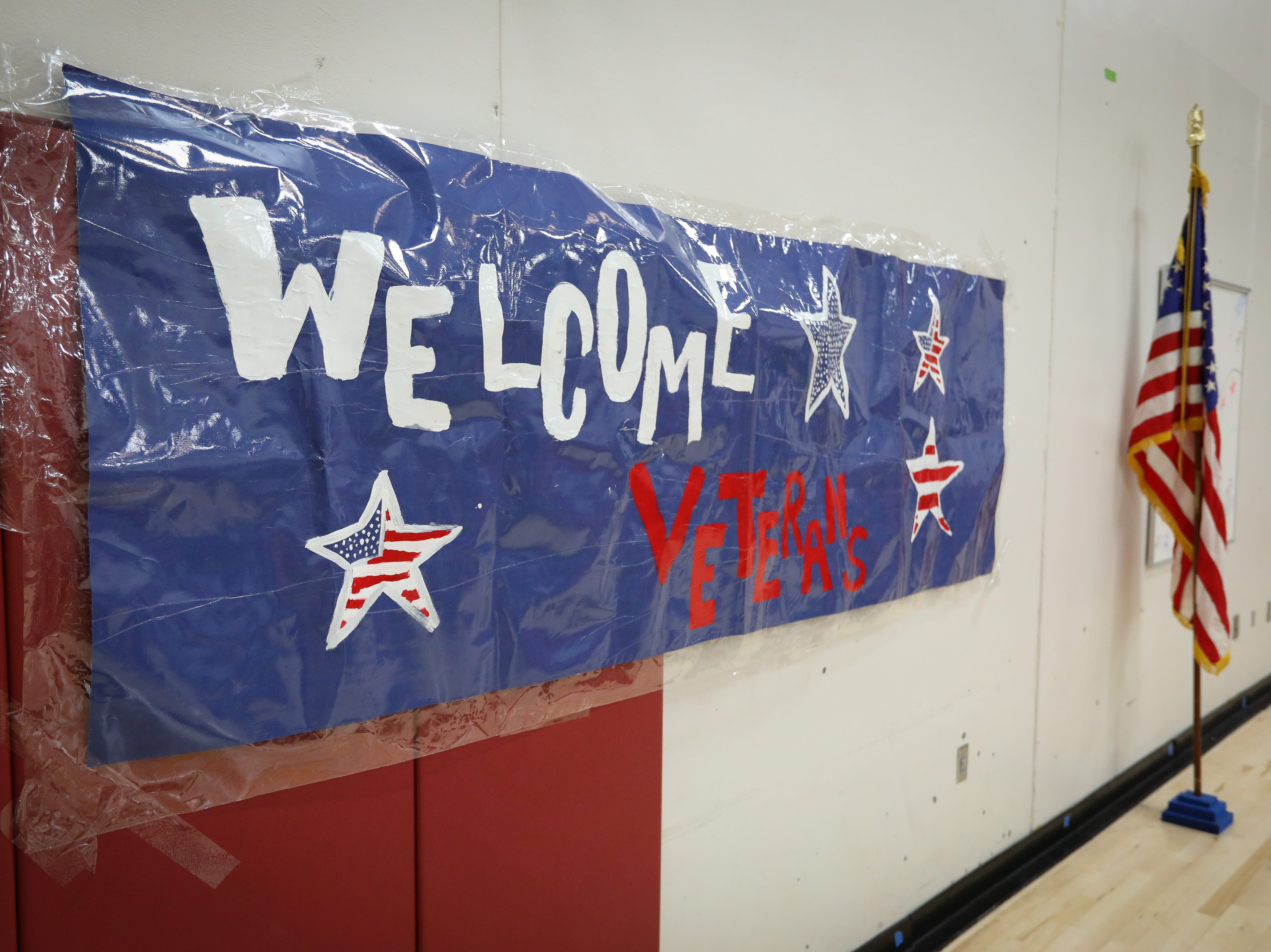 A sign welcomes attendees at a Veterans Day Breakfast at Northview Middle School on Wednesday, Nov. 14, 2018 in Ankeny, Iowa. Middle school students hosted the veterans to share their gratitude before an assembly.