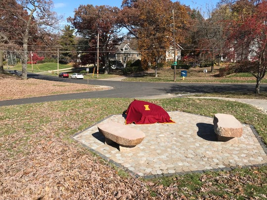 A boulder covered in an Iowa State letter blanket will be unveiled Nov. 25, a new memorial to honor the lives of ISU women's cross county team members who died in a 1985 airplane crash. The boulder sits in line with the crash site across the intersection, near the second telephone pole from the right.