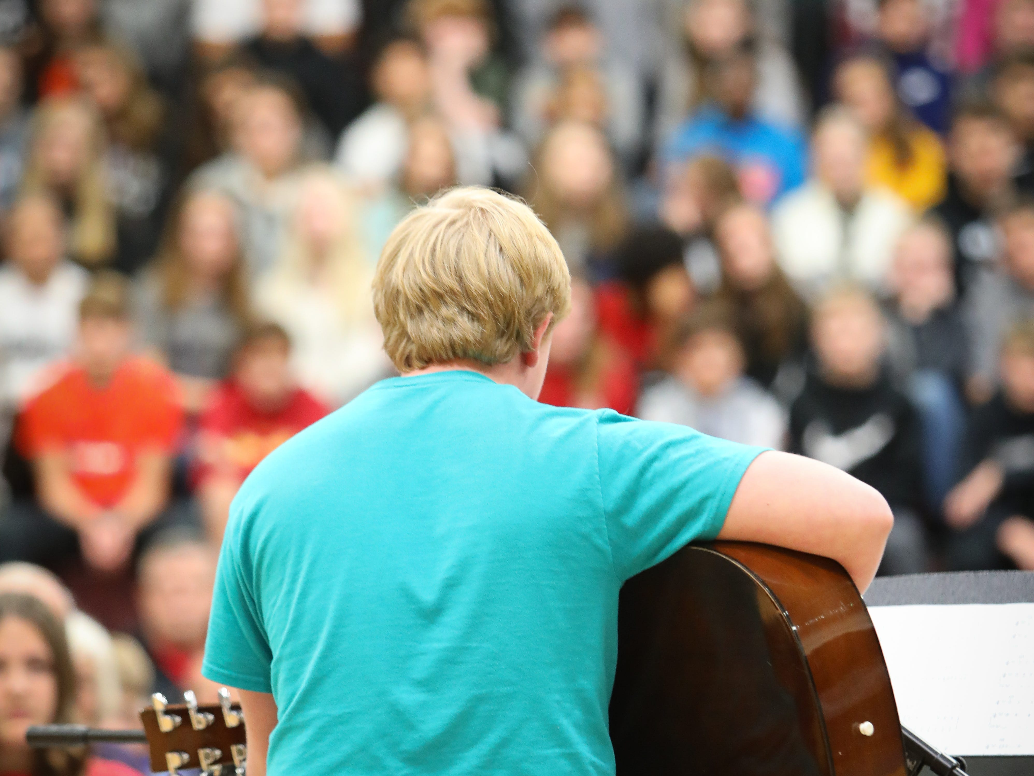 """Corbin Emminger plays """"8th of November"""" by Big and Rich on the guitar during Veterans Day Breakfast at Northview Middle School on Wednesday, Nov. 14, 2018 in Ankeny, Iowa."""