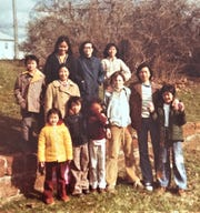 Ky Phan Luong (second from right) in Des Moines, with fellow refugees and Iowan friends, in the late 1970s.