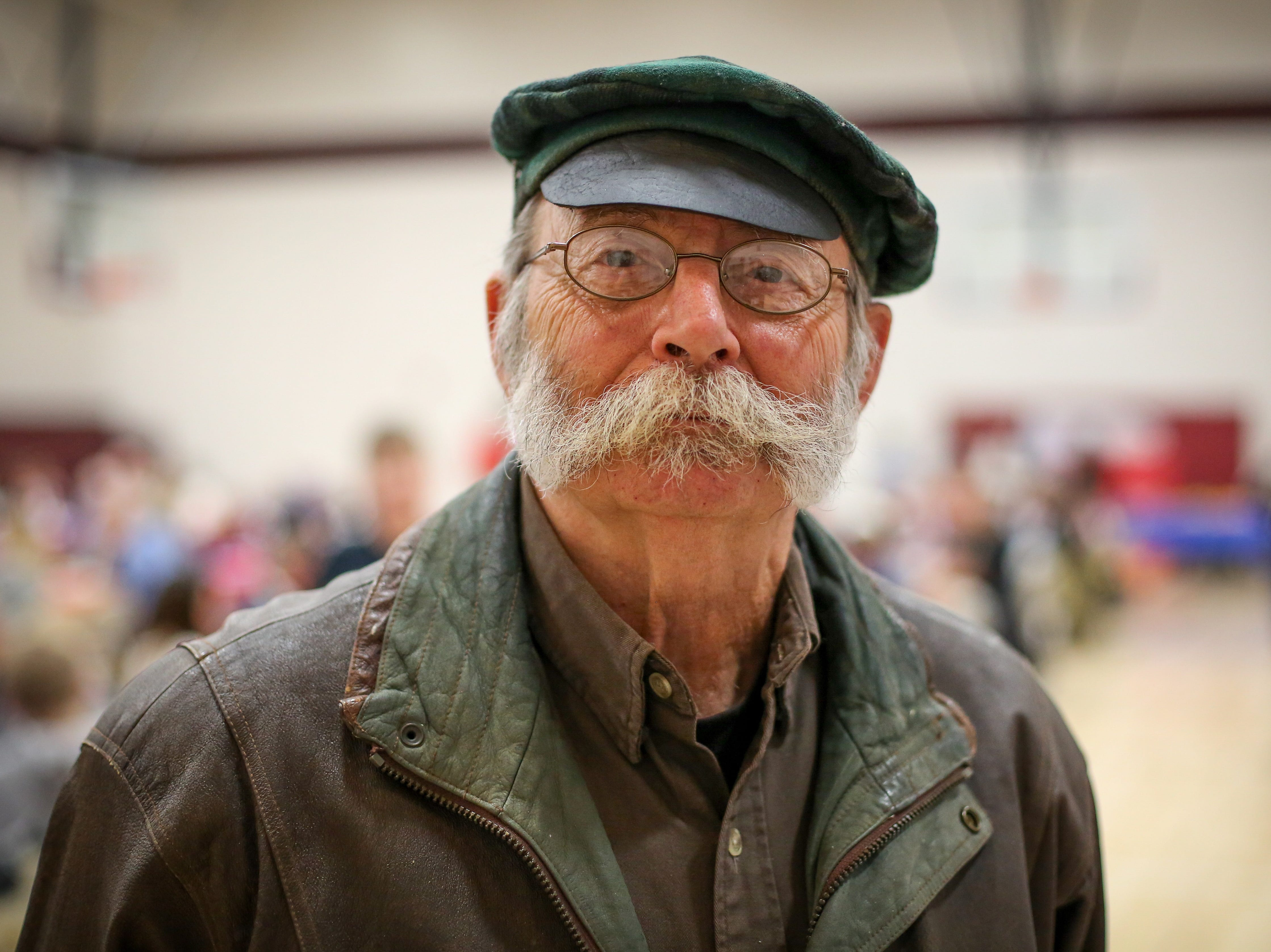 Roger Shannon, an Army veteran, shows off his mustache during Veterans Day Breakfast at Northview Middle School on Wednesday, Nov. 14, 2018 in Ankeny, Iowa.