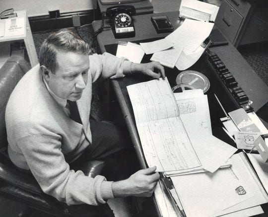 From 1970: Dowling football coach Jim Williams works on game planning in his office.