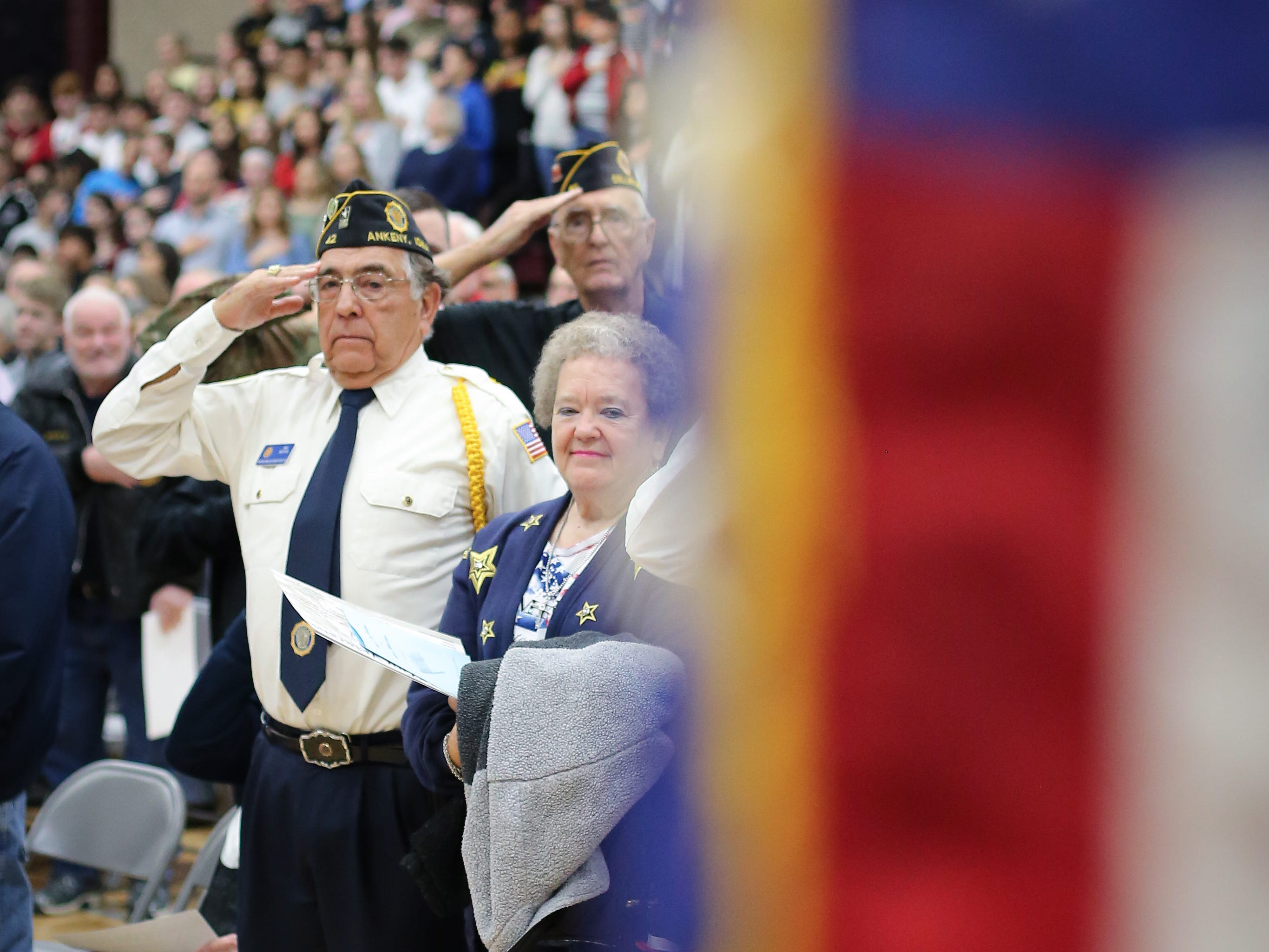 A veteran salutes to the United States flag during the national anthem at the Veterans Day Breakfast at Northview Middle School on Wednesday, Nov. 14, 2018 in Ankeny, Iowa. Middle school students hosted the veterans to share their gratitude before an assembly.